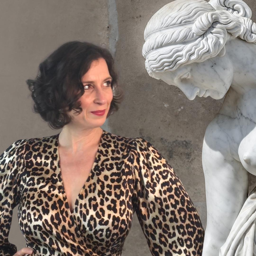 art historian eyeing up a statue of Venus
